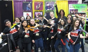Heather Gonzalez with Rockn' Stringz and Mark Wood at our booth at TMEA